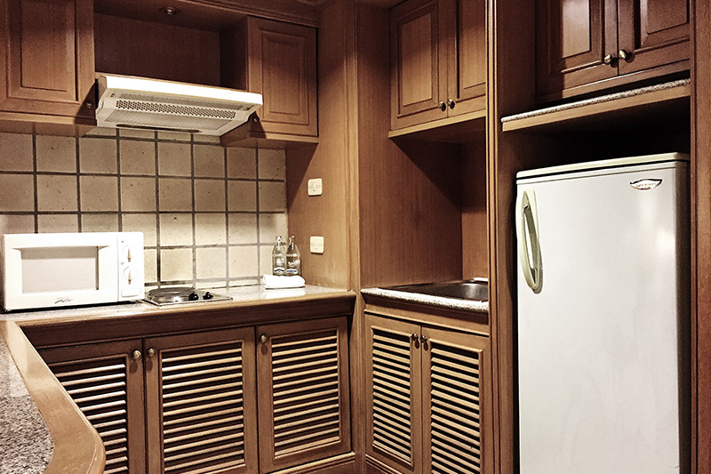 a kitchen of a 2 bedroom suite