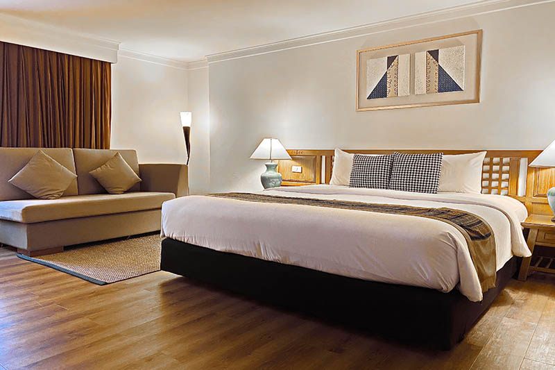 a bed in a business executive room 1