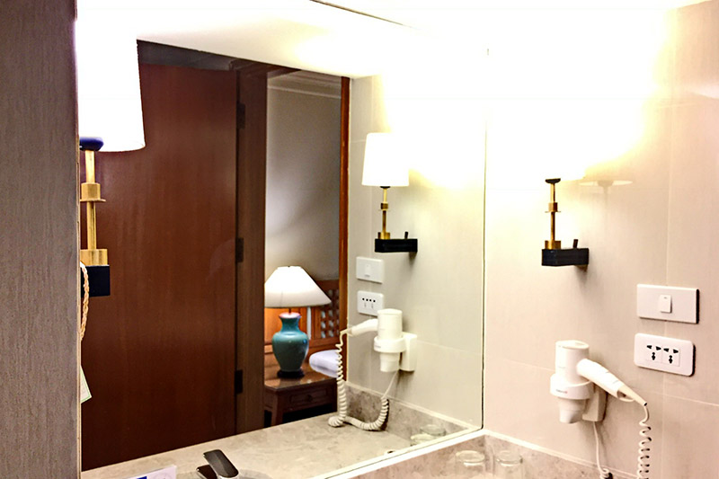 a bathroom of a business executive room 1