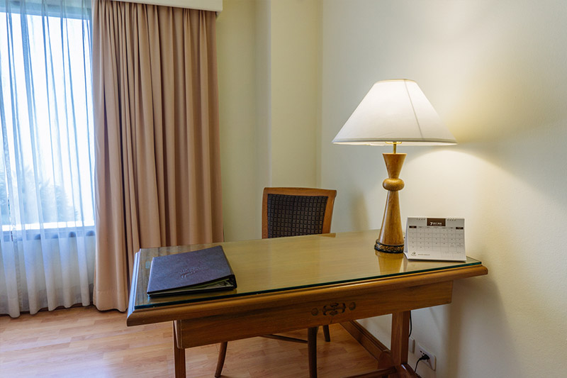 a desk in a deluxe room
