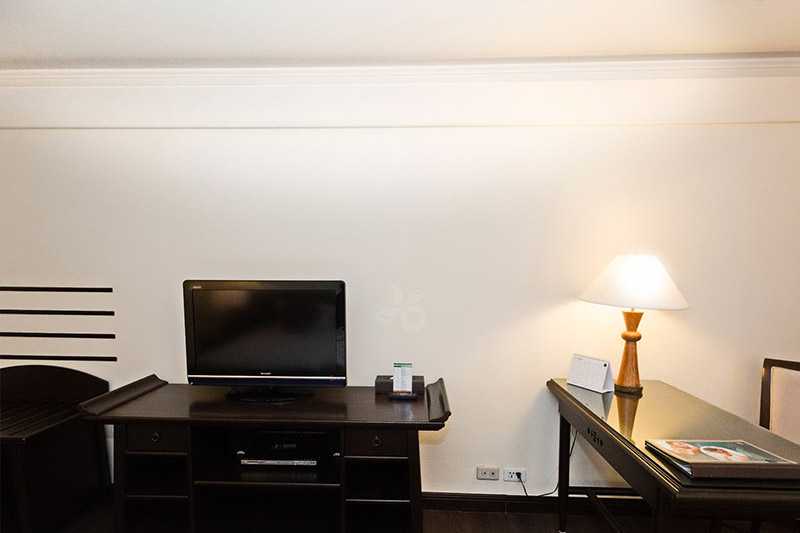 a desk and a television in a permium deluxe room